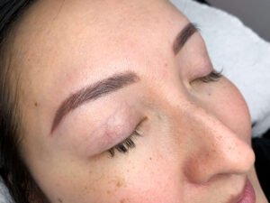 Eyewonderlust Melbourne Eyebrow Tattoo- Eyebrow Tattoo Reviews Woman with Tattooed Combination Eyebrows Eyes Closed